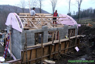 Trusses wire up sugar mountain farm for Barrel roof trusses